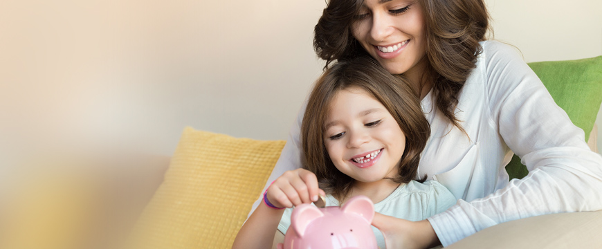 Savings & Money Market Image of Mother & child with piggy bank